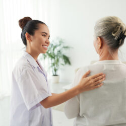 Nurse speaking with older patient about care and caregiver options | cCARE | Fresno & San Diego, CA