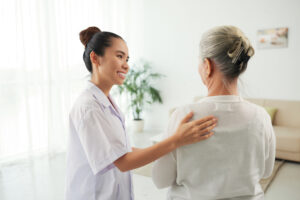 Nurse speaking with older patient about care options | cCARE | Fresno, CA