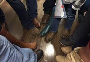 cCARE nurses all in cowboy boots to celebrate with Jaxson, featured in this story about his fight against Rhabdomyosarcoma | cCARE | Fresno & San Diego, CA