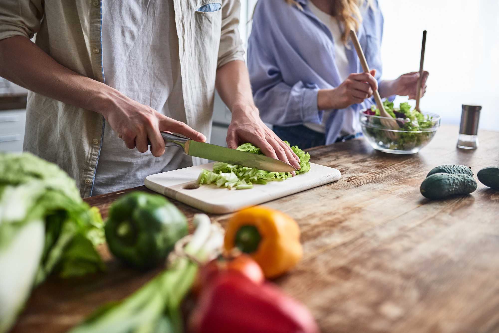 Couple making a healthy meal | Weight & Cancer | cCARE | San Diego and Fresno, CA