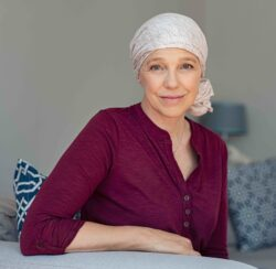Cancer Overview | cCARE, San Diego & Fresno | Woman living with cancer | cCARE | San Diego and Fresno, CA | Woman in headscarf living with cancer