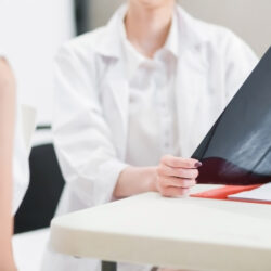 Female patient discussing breast cancer awareness with doctor | cCARE | San Diego and Fresno, CA